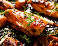Grilled chicken breast with thyme, lemon and vegetables stock photos