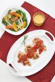Grilled chicken breast with tomato tarragon sauce. Royalty Free Stock Images