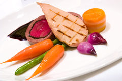 Grilled Chicken Breast with Veal Tenderloin Terrine. Veal tenderloin terrine coupled with grilled chicken breast. Served with potatoes and buttered seasonal Stock Images