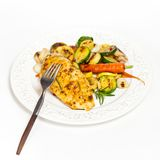 Grilled chicken breast with vegetables Stock Images
