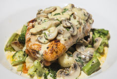 Grilled chicken breast and vegetables with creamy mushroom sauce Stock Image