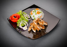 Grilled chicken breast with vegetables on plate Stock Image