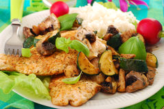 Grilled chicken breast with zucchini and mushrooms Stock Photos