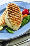 Grilled chicken breasts. On a plate with fresh vegetables Stock Photo