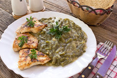 Grilled chicken breasts with cooked green beans in plate on wood. Grilled chicken breasts with cooked green beans in plate on old  wooden table Stock Image