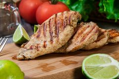 Grilled chicken breasts. On a cutting board Royalty Free Stock Photos