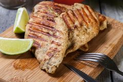 Grilled chicken breasts. On a cutting board Stock Images