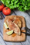 Grilled chicken breasts. On a cutting board Stock Photography