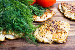Grilled chicken breasts fillet with fresh vegetables Stock Images