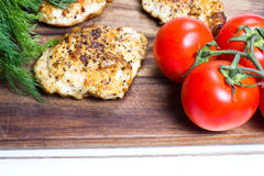 Grilled chicken breasts fillet with fresh vegetables Royalty Free Stock Images
