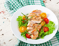 Grilled chicken breasts and fresh salad Stock Image