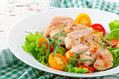 Grilled chicken breasts and fresh salad Stock Photography