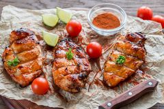 Grilled chicken breasts in hot mango sauce Stock Photos