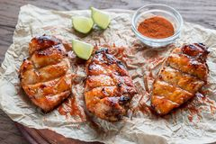 Grilled chicken breasts in hot mango sauce. Close up Royalty Free Stock Photos