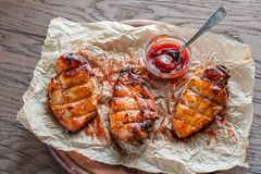 Grilled chicken breasts in hot mango sauce Royalty Free Stock Photography