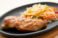 Grilled chicken breasts and noodles. Japanese cuisine Royalty Free Stock Image