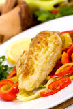 Grilled chicken breasts on a plate with fresh vege stock photos