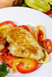 Grilled chicken breasts on a plate with fresh vege stock photo