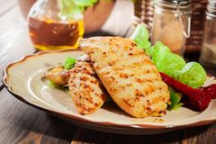 Grilled chicken breasts served with grilled paprika. On a plate Stock Photography