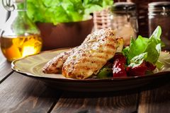 Grilled chicken breasts served with grilled paprika. On a plate Stock Image