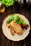 Grilled chicken breasts served with grilled paprika. On a plate Royalty Free Stock Photo