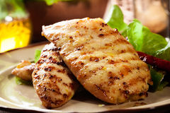 Grilled chicken breasts served with grilled paprika Stock Photography