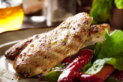 Grilled chicken breasts served with grilled paprika. On a plate Stock Photo