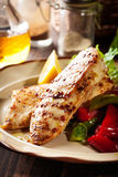 Grilled chicken breasts served with grilled paprika. On a plate Stock Photos