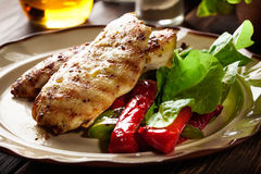 Grilled chicken breasts served with grilled paprika. On a plate Royalty Free Stock Photos