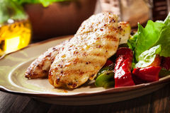 Grilled chicken breasts served with grilled paprika Royalty Free Stock Photo