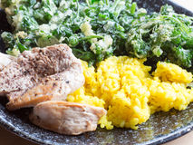Grilled chicken breasts and  turmeric rice. On the table Royalty Free Stock Photos