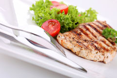 Grilled chicken breasts and vegetables Stock Photos