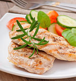 Grilled chicken breasts and vegetables Stock Images