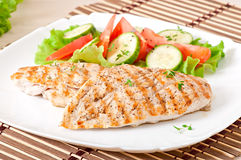Grilled chicken breasts and vegetables Stock Photo