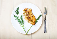 Grilled chicken breasts on a white plate Royalty Free Stock Photography