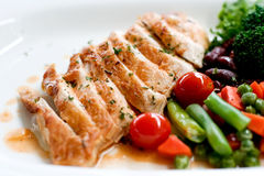 Grilled chicken. With brown sauce and grilled vegetable Royalty Free Stock Photography