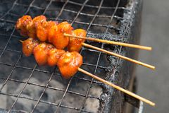 Grillled chicken buttock. Grilled chicken buttock on street in Malaysia royalty free stock photo
