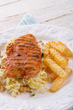 Grilled chicken, cabbage salad with nuts and chips Stock Images