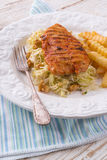 Grilled chicken, cabbage salad with nuts and chips Stock Photos