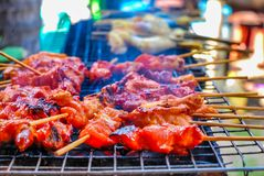 Grilled chicken on charcoal grill stock photography