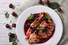 Grilled chicken with cherry sauce close up. horizontal top view Stock Image
