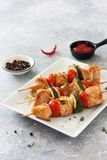 Grilled chicken , cherry tomatoes, onions and zucchini skewers Stock Images
