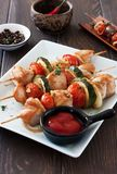 Grilled chicken , cherry tomatoes, onions and zucchini skewers Stock Photography