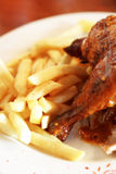 Grilled chicken and chips Stock Images