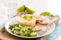 Grilled chicken with couscous and salad Stock Images