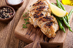 Grilled chicken on a cutting board Royalty Free Stock Photos