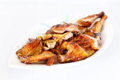 Grilled chicken on dish Stock Images