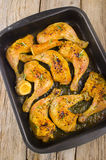 Grilled chicken drumstick in a baking tray Stock Image