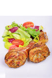 Grilled chicken drumstick with vegetables Royalty Free Stock Images