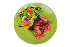 Grilled chicken drumstick with vegetables on the plate Stock Image